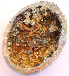 Bismuth Geode/ bismuth that has been grown and cooled in an eggshell! Apparently bismuth is one of the easiest crystals to grow yourself. I found instuctrions at About.com?chemistry. Bismuth does not naturally occur in geode form. What fun to create your own dragon's egg!