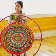 Weaving a rug on a hula hoop sounds like an ideal weekend project to us. #DIY