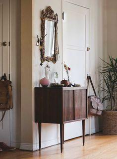 Entryway. Mid-century modern with boroque mirror.