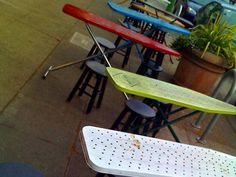 What a cute idea - cafe tables with metal ironing boards - from The Stir