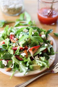 Kale Salad with Goat Cheese, Almonds, Sunflower Seeds, and Strawberry-Mint Vinaigrette - perfect for Spring! #kale #salad #vegetarian