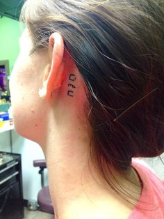 Name in Hebrew tattoo behind ear