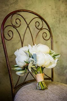 All white bridal bouquet // Photo By: http://beautifuldayphotography.com