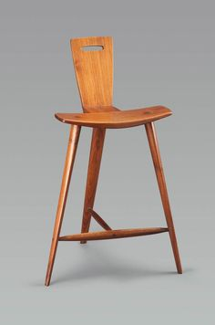 3-legged Tage Frid stool build in 1979 out of walnut.
