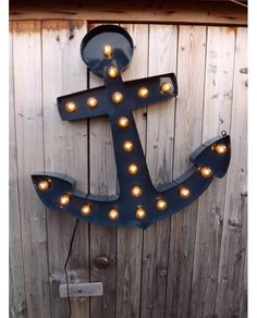 Marquee light anchor sign LARGE. Large navy blue anchor sign with edison style light bulbs. Marquee light can be customized with different cords, colors or light bulbs. Great nautical, retro, funky or chic home decor. Awesome bar decor, home decorations or could be a perfect addition in a baby boy's nursery. https://www.aftcra.com/hitandmisslimited/listing/6007/marquee-light-anchor-sign-large