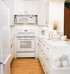 Small white kitchen with laminate floors