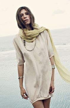 dress and scarf on the beach.