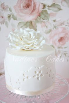 Simple and pretty white eyelet mini cake.