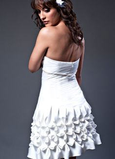 Short wedding dress with origami pleated skirt and top.