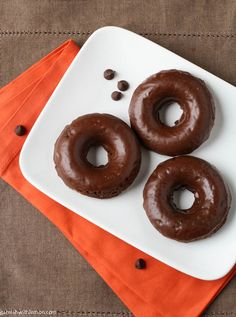 Delicious baked chocolate donuts with a touch of cinnamon and cayenne.