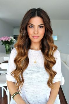 This middle part with loose wand curls is a trend that we are loving!