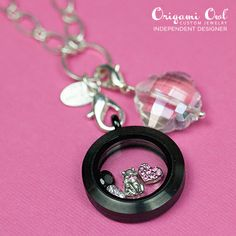 CAT-THEMED LIVING LOCKET - Origami Owl Living Locket... FREE CHARM WITH A $25 OR MORE PURCHASE... Contact me to place your order YourCharmingLocket@gmail.com or message me on Facebook https://www.facebook.com/YourCharmingLocket. Or just place your order on our website http://yourcharminglocket.origamiowl.com/ ---LIKE OUR FAN PAGE FOR A CHANCE TO WIN A FREE CHARM. 3 WINNERS EVERY MONTH--- Want more than just one locket, consider joining our team for an extra income