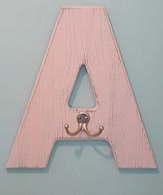 Letter hooks with each kid's initial for the bathroom.