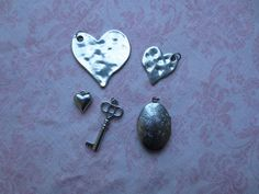 Destash assorted size and shape key, heart and locket silver tone charms. Wholesale lot of 5