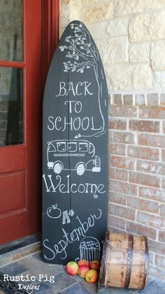 It looks like a surfboard, but it's an ironing board! This would be awesome in my son's nautical-themed bedroom. Chalkboard Ironing Board Welcome Sign -Momo