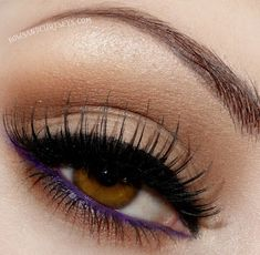 A bright purple eyeliner on the water-line for a pop of color. Bright blue and green eyeliner works great also.