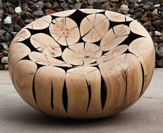 a beautiful smooth wood trunk chair by Jaehyo Lee