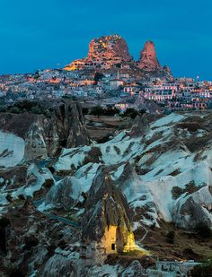 The Uchisar Castle towering over the Fairy Chimneys in Göreme, Cappadocia, Turkey. An UNESCO World Heritage Site. (by Nomadic Vision Photography)