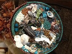 Microwave plate, beads, shells and drift wood.