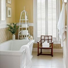 The Guest Bath | Used as a wainscot, the graphic tone-on-tone tile (annsacks.com) offers a nice backdrop to the handsome, extra deep freestanding bathtub (kallista.com). | #SLIdeaHouse | SouthernLiving.com