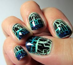 i'm guessing black opi crackle above sponged on blue tips on green nails.