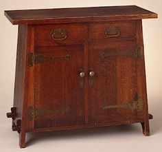 I like the shape and angles of this cellarette of oak and copper; the hand-made hardware, the through tenons, it all works for me; by the Furniture Shop of the Roycrofters c.1906