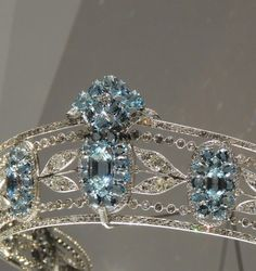 Detail view of BELLE EPOQUE AQUAMARINE AND DIAMOND TIARA, CIRCA 1910. Designed as a series of graduated oval aquamarine clusters set with oval- and hexagonal-shaped aquamarines, interspersed with sprays of diamond myrtle leaves, within millegrain borders of circular-, single- and rose-cut diamonds. Part of the estate of Christian, Lady Hesketh. Cartier