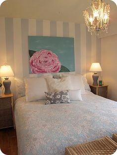 striped wall, flower canvas, bedspread...