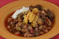 Slow Cooker Cowboy Beans made with dry pinto beans are sure to be a hit at your next potluck or backyard barbecue get-together.