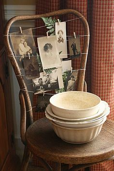 Using the back of a chair as a way to display photos (or Christmas cards!) with string/twine and clothes pins. From Mamie Jane's: Chair Redo