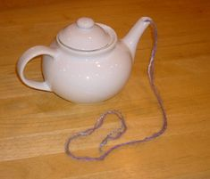 Use a tea pot in the place of a yarn bowl to keep your skeins secure. Awesome idea!