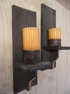 Primitive barnwood wall sconces. Great for the living room.