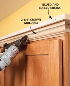 Update Kitchen Cabinets with crown molding.