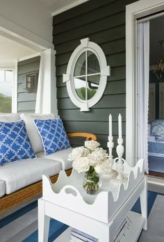 black and white house with blue and white porch furnishings