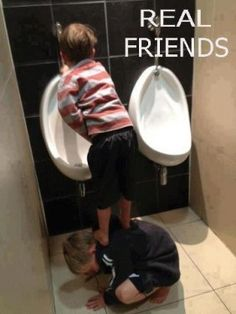 This is a real friend - even at this age.  This is to precious (unless Little Johnnie is forcing Little Bobby to do this :)