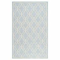 """Showcasing a quatrefoil-inspired trellis motif, this hand-tufted wool rug adds eye-catching appeal to your living room or study.  Product: RugConstruction Material: WoolColor: Light blue and ivoryFeatures:  Hand-tuftedMade in IndiaQuatrefoil-inspired trellis motif Pile Height: 0.63"""" Note: Please be aware that actual colors may vary from those shown on your screen. Accent rugs may also not show the entire pattern that the corresponding area rugs have."""