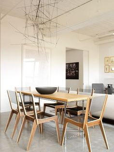 modern dining room by Croma Design Inc:  Lines form as lighting of dining room.