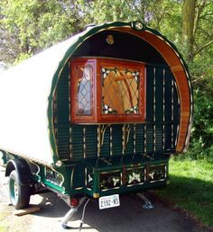 Gypsy caravan...love the stained glass window!