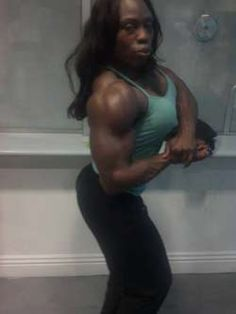 Black Muscular Domina Mistress Treasure Flexes Her Muscles