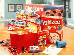 """One of the best raffle """"baskets"""" I ever saw was themed """"Family Game Night"""" and was a tower of games stacked one on top of other. Hit of the basket raffle! Game/Activity basket theme. Fill with all kinds of card games, and puzzles and coloring books, crayons"""