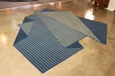A Rug That Resembles a Folded Sheet of Paper - Design Milk