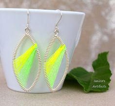 Peruvian style earrings with fluorescent thread