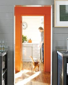 love this pop of color in the doorway playing off the neutral grays and whites in the other rooms