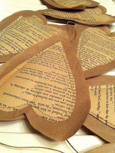 Paper hearts made of old book pages. gift, old book pages, valentine day, paper hearts, kraft paper, ribbon, garland, antique books, old books