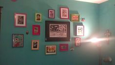 my day of the dead wall in the living room. I love my teal walls. more artwork to come.