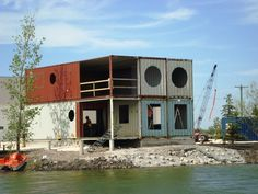IN THE BOX : The Build of a Beach Container House. IN THE BOX focuses on this Custom Container House by ADM Storage; using 6, 40ft Hi-Cubes at an avg. cost of $1500 - $2000 a piece, yielding a $200,000+ Beach House for under $80,000 or even $50,000 depending what you put into it.