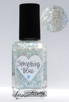 Lynnderella Limited Edition—Something Blue. is the first in a series of four new bridal-themed lacquers. It contains assorted whites accented with pastel and iridescent blue glitters in an aqua- and blue-shimmered clear base.