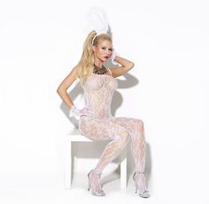 White rose pattern lace bodystocking. Featuring a low, scooped neckline, slender straps, and open crotch. This bodystocking is designed to showcase your curves beautifully!