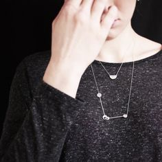 Delicate silver necklaces are perfect for layering.