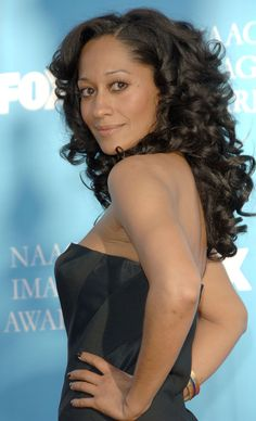 Tracee Ellis Ross Rollerset. Achieve a similar look with Capelli Care Hourglass Rollers in Aqua or Yellow or Halo Rollers in Yellow or Orange.